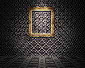 Golden picture frame on the wall — Stock Photo