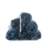 Stack of rolled jeans with tape measure — Stock Photo