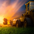 Yellow tractor in a field — Stock Photo #50851075