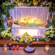 Jesus Christ lying dead in symbolic grave - Stock Photo