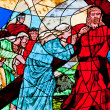Stained glass showing Jesus carrying the cross — Stock Photo