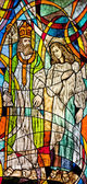 Stained glass showing Bishop Nicholas and believer — Stock Photo