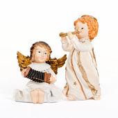 Angelic figurines playing music — Fotografia Stock