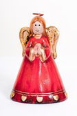 Angel figurine praying and smiling — Stock Photo