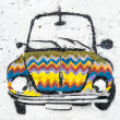Street graffiti displays colorful car — Stock Photo
