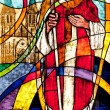 Stock Photo: Stained glass showing bishop