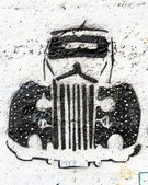 Street graffiti displays old car — Stock Photo