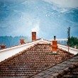 Rooftops with smoking chimneys in winter — Stock Photo