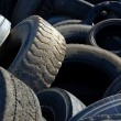 Old car tires stacked in a pile — Stock fotografie