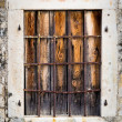 Rusty metal window with bars — Stock Photo