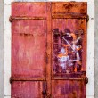 Red rusty metal window — Stock Photo