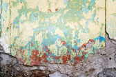 Textured wall that is crumbling with red stains — Stock Photo