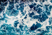 Deep blue sea water with spray — Stock Photo