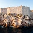 View from the open sea to the defensive city walls of Dubrovnik — Stock Photo