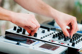 Close-up of sound mixer control panel with dj hands — Stock Photo