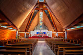 Interior of large modern catholic cathedral with high ceiling — Stock Photo