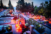 Dalmatian cemetery in Croatia at dusk with many flowers and cand — Stock Photo