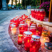 Lots of candles at dusk at cemetery in Dalmatia, Croatia — Stock Photo