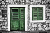 Decrepit green door and window on the Dalmatian house in Croatia — Stock Photo