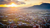 Small Dalmatian city lit by sunlight at sunset — Stock Photo