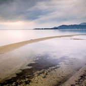 Sandy beach and calm waters at sunset in southern Croatia — Stock Photo