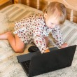Little girl is sitting at the computer — Stock Photo