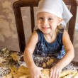 Stock Photo: Child knead dough in kerchief