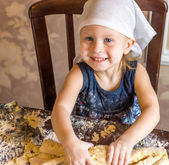 Child knead the dough in a kerchief — Stock Photo