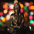 Royalty-Free Stock Photo: Buddha figure on multicolored background