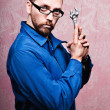Royalty-Free Stock Photo: Sexy bizarre repairman holding wrench with humor
