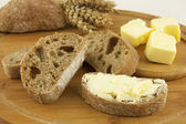 Composition with bread and butter — Stock Photo