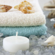 Spa still life with bath towels and natural salt crystals - Стоковая фотография