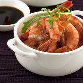 Shrimps on a white dishes — Stock Photo