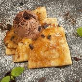 Tasty crepes with ice cream — Stock Photo