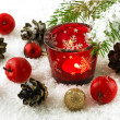 Christmas still life with candles and fir tree branches — Stock Photo