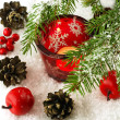 Christmas still life with candles and fir tree branches — Stockfoto