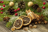 Christmas spices on wooden surface — Stock Photo