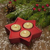 Christmas candles on a wooden surface — Photo