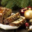 Slice of Christmas cake decorated with walnuts — Stock Photo #33700849