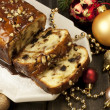 Slice of Christmas cake decorated with walnuts — Stock Photo