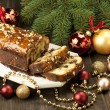Slice of Christmas cake decorated with walnuts — Stock Photo #33700857