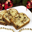 Slice of Christmas cake decorated with walnuts — Stok fotoğraf #33700867