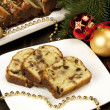 Slice of Christmas cake decorated with walnuts — Stock Photo #33700871