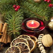 Christmas still life with spices and candle — Stock Photo