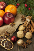 Christmas still life with fruit and spices — Stock Photo