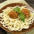 Bowl with meatballs and pasta with tomato sauce — Stock Photo