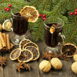 Mulled wine with slice of orange and spices — Stock Photo #34092647