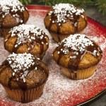 Christmas sweet muffins with chocolate glaze — Stock Photo