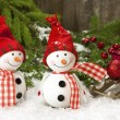Happy snowman with christmas decoration — Stock Photo