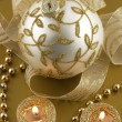 Christmas decorations with candles and christmas bauble — Stock Photo #35133367